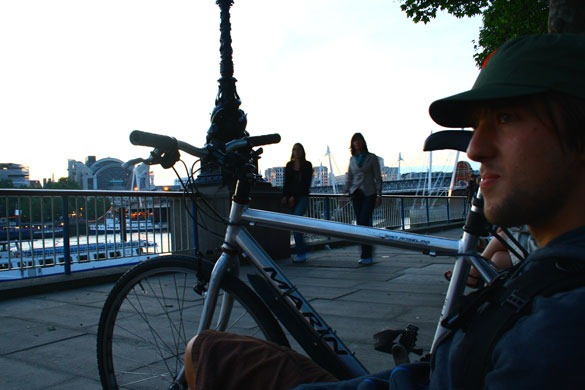 London Cyclist by the River
