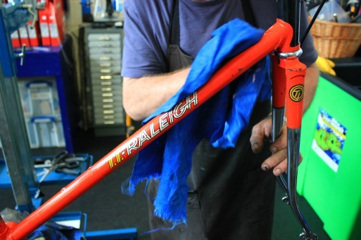 polishing the bike frame