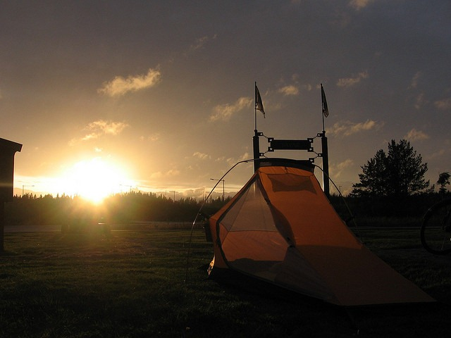 Tent with the sun in the background